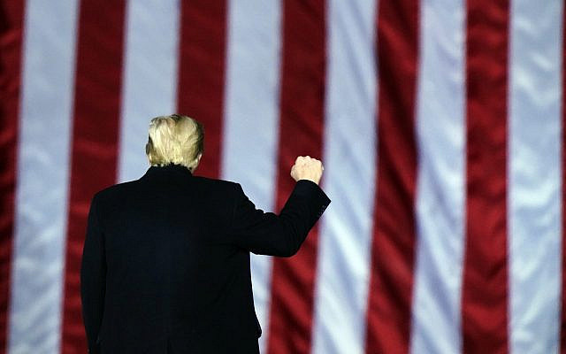 US President Donald Trump gestures at a campaign rally in support of US Senate candidates Sen. Kelly Loeffler, R-Ga., and David Perdue in Dalton, Georgia, January 4, 2021. (AP Photo/Brynn Anderson)