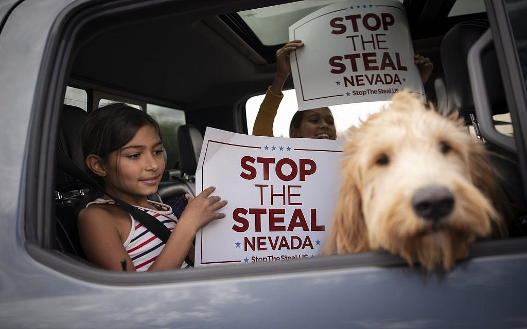 Supporters of President Donald Trump gather outside of the Clark County Elections Department in North Las Vegas, Nev. Saturday, Nov. 7, 2020. (AP Photo/Wong Maye-E)