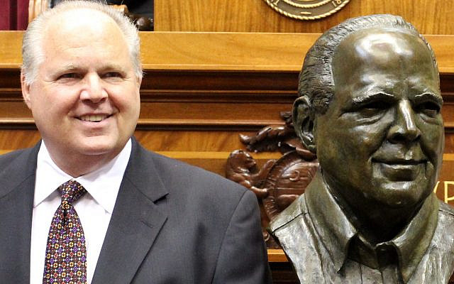 Rush Limbaugh, next to his bust, in 2012. (Progress Missouri, Wikipedia)