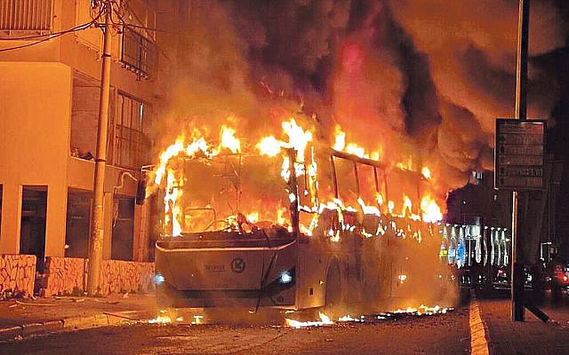 Bus torched by Orthodox lockdown rioters (via Jewish News)