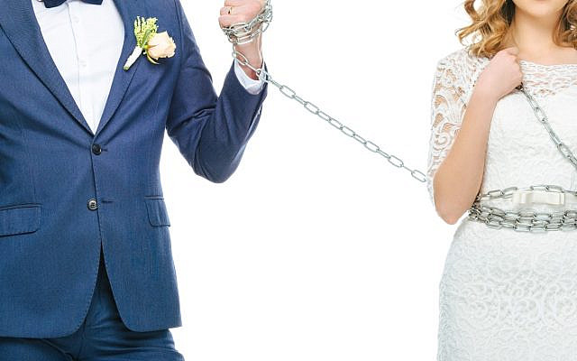 A married couple, with the wife in chains. (iStock)