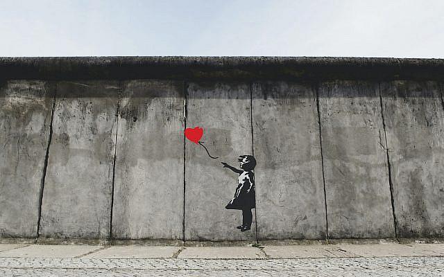 Banksy's artwork in Berlin, Germany (Photo by Eric Ward on Unsplash via Jewish News)