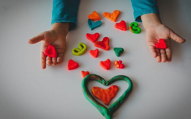 Making hearts from clay for Valentine's Day. (iStock)
