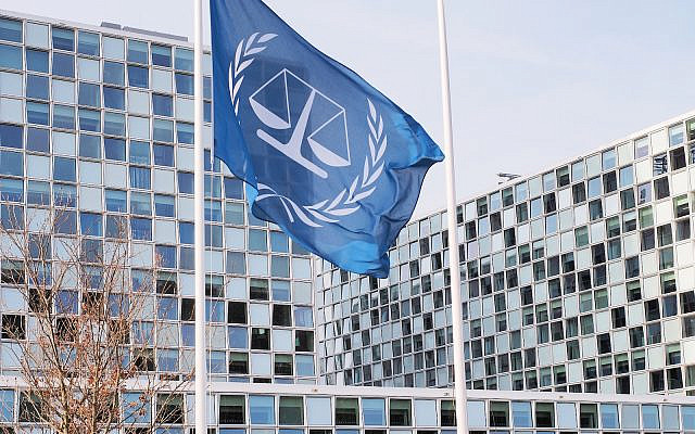 The flag and the International Criminal Court at the International Criminal Court building. The Hague, Netherlands - March 27, 2016. (iStock)