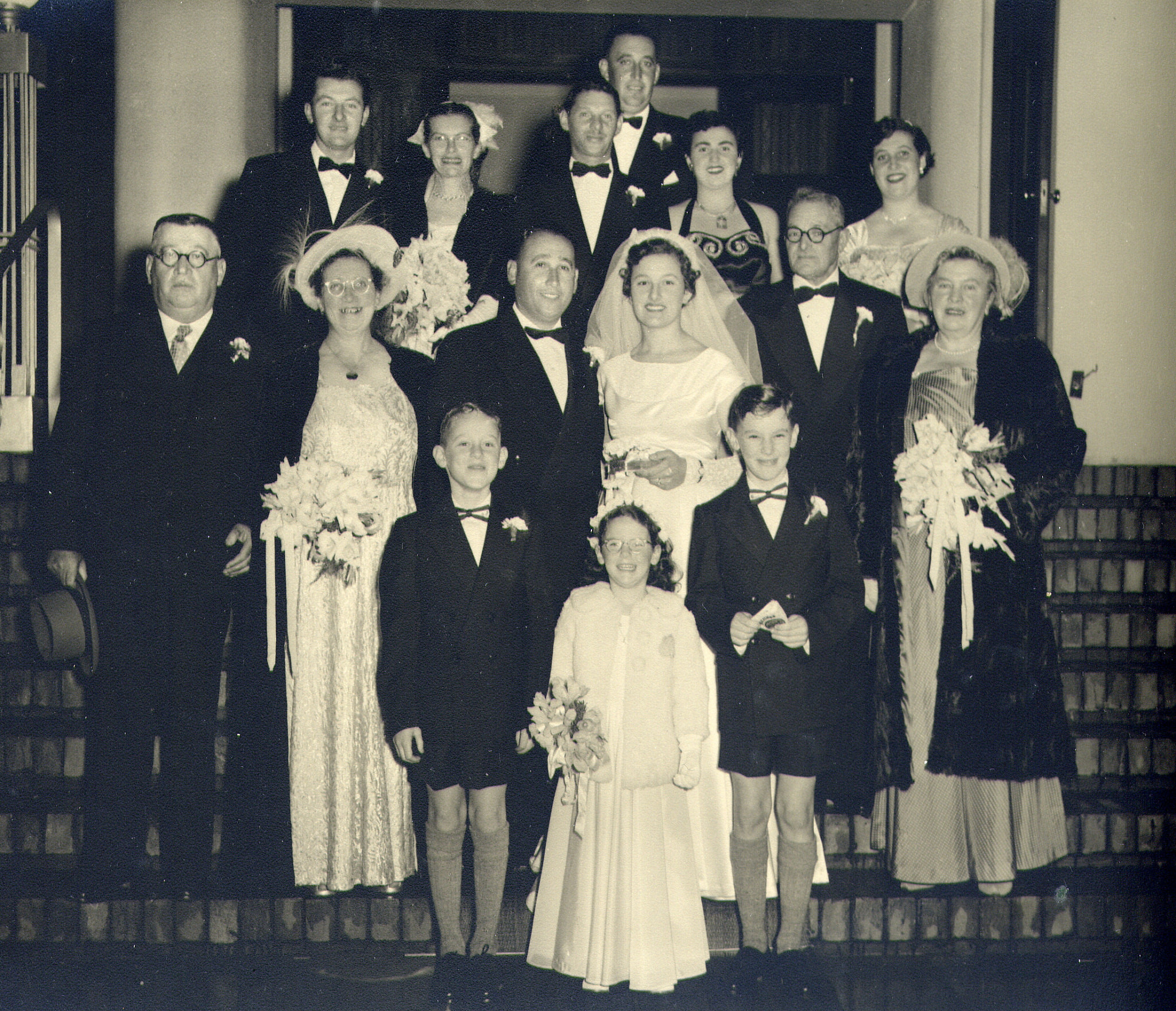 Vicky and Nokkie Scher on their wedding day. Golda Scher next to the groom, Judith Sher, behind the bride with Hanke next to her.