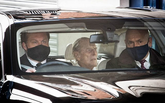 The Duke of Edinburgh is driven away in a car after leaving the King Edward VII's Hospital, London, where he has been recovering after heart surgery. (PA Wire/PA Images /Stefan Rousseau via Jewish News)