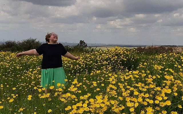 The author running free in a field of yellow flowers.