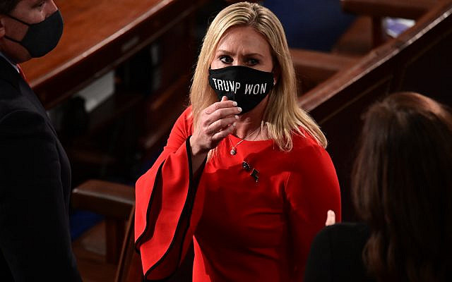 In this Sunday, Jan. 3, 2021, file photo, Rep. Marjorie Taylor Greene, R-Ga., wears a 'Trump Won' face mask as she arrives on the floor of the House to take her oath of office on opening day of the 117th Congress at the US Capitol in Washington. (Erin Scott/Pool Photo via AP, File)