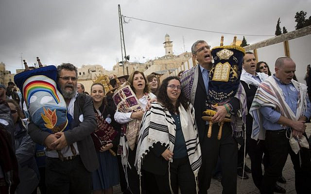 In this Nov. 2, 2016 photo, the heads of the Reform and Conservative movements carry Torah scrolls as they march to the Western Wall. (AP Photo/Sebastian Scheiner, File)