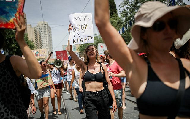 Israeli protesters chant slogans as they march in the SlutWalk in central Jerusalem, on May 24, 2019. The SlutWalk originated in Toronto in 2011, with subsequent rallies occurring globally, to protest against explaining or excusing rape by referring to a woman's appearance. (Yonatan Sindel/Flash90)
