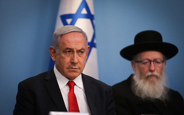 Prime Minister Benjamin Netanyahu (L) and Health Minister Yaakov Litzman during a press conference about the coronavirus at the Prime Ministers Office in Jerusalem on March 8, 2020. (Yonatan Sindel/Flash90)
