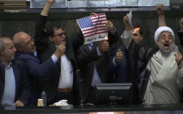 Iranian politicians burning US flag (picture from Times of Israel)