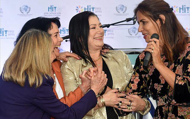 "Popular singer Einat Sarouf (right), congratulates ""Woman of Valor"" award winners Sarah Allalouf, honorary consul of Latvia; Professor Idit Matot of Tel Aviv Ichilov, and Benita Elkon-Baitner of Pfizer Israel. (Larry Luxner)"