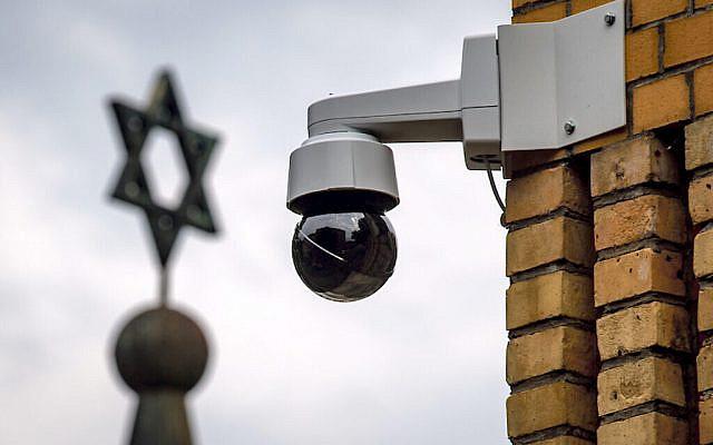 A surveillance camera can be seen next to a Star of David (Photo: Hendrik Schmidt/dpa-Zentralbild/dpa) via Jewish News