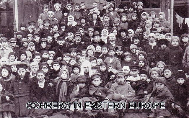 """""""Daddy Ochberg"""". Isaac Ochberg (center) with his rescued orphans in 1921 in Eastern Europe before leaving for South Africa."""