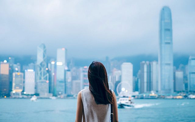 A woman enjoying the skyline at dusk (Getty Images)