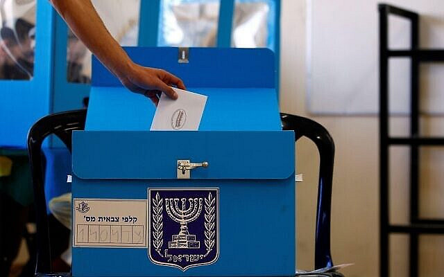 An Israeli soldier casts his early vote in the March 23 general election, amid the coronavirus disease (COVID-19) crisis, at a mobile polling station at a military base, near Kibbutz Regavim, Israel March 17, 2021. REUTERS/Corinna Kern. Via Jewish News