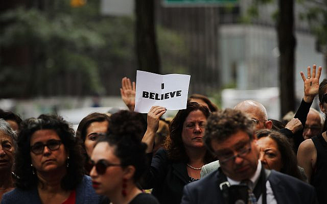 NEW YORK, NY - SEPTEMBER 27:  Dozens of protesters against the confirmation of Republican Supreme court nominee Judge Brett Kavanaugh gather outside of Democratic Senator Chuck Schumer's office on the afternoon that the nation is watching Professor Christine Blasey Ford testify against Kavanaugh on September 27, 2018 in New York, New York. As people around the country watched, Ford gave emotional testimony about the alleged sexual assault before the Senate Judiciary Committee Thursday morning. Kavanaugh has strongly denied all of the sexual misconduct allegations against him and is to be questioned separately at the same hearing later in the day. The protesters were to deliver a letter of thanks to Schumer's office for his vote against Kavanaugh. (Spencer Platt/Getty Images via JTA)