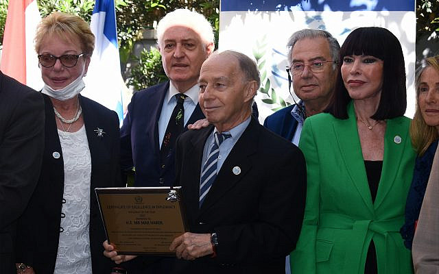 """Max Haber, Paraguay's longtime ambassador to Israel, receives a plaque recognizing him as """"Diplomat of the Year"""" during an April 13 ceremony in Herzliyya. (Larry Luxner)"""