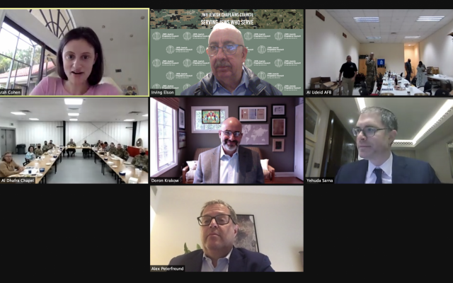 JWB Jewish Chaplains Council® Zoom Seder for AGJC, March 2021. Right to Left, Top to Bottom: #1: Sarah Cohen, Executive Director of AGJC; #2 Rabbi Irving A. Elson, CAPT, USN (Ret)| Vice-President, Director, JWB Jewish Chaplains Council; #3: (walking off screen) Dan Wise, JWB Jewish Lay Leader, Seder at Al Dhafra Air Base in Abu Dhabi; #4: Al Udeid Air Force Base outside of Doha, Qatar; #5: Doron Krakow, president and CEO, JCC Association of North America; #6: Rabbi Yehuda Sarna, honorary chairman of AGJC; #7: Alex Peterfreund, Hazan for UAE and AGJC Board member. (courtesy)