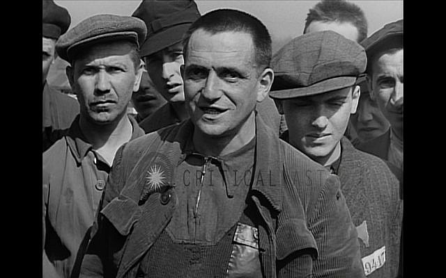 The author's father, German Jewish internee Otto Feuer of Buchenwald Concentration Camp, is interviewed following the camp's liberation by the US army in April 1945. (Screenshot)