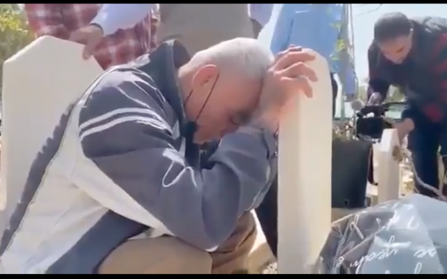 Rushdi Abu Mokh praying at the grave of his mother who died two years before his release, last week. (Screenshot from Twitter via Jewish News.)