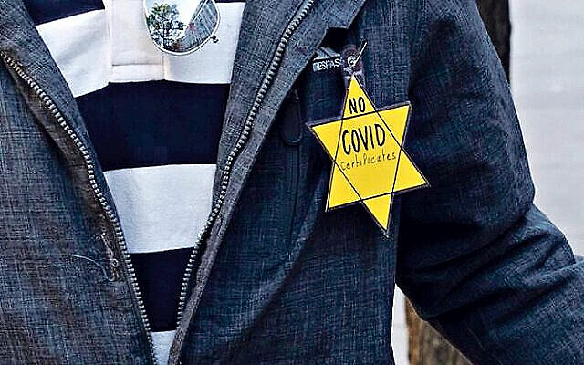 Demonstrator dons a yellow star at a recent anti-Covid protest