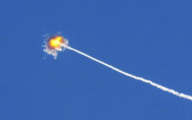 Israel's Iron Dome rocket defense system intercepts and destroys a rocket that terrorist organization Hamas launched and targeted towards innocent civilians. [photo credit: AFP/JACK GUEZ]