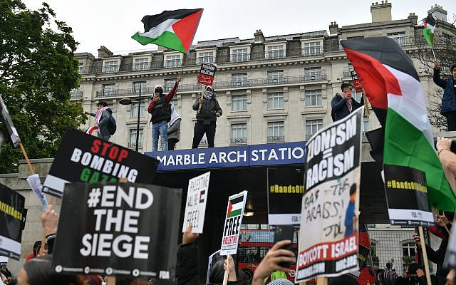 People gather at Marble Arch in central London, ahead of a march in solidarity with the people of Palestine amid the ongoing conflict with Israel. Picture date: Saturday May 15, 2021. (Via Jewish News/Press Association)