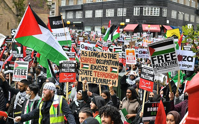 Demonstrators walk through Kensington as they make their way to the Israeli embassy in London, during a march in solidarity with the people of Palestine amid the ongoing conflict with Israel. Picture date: Saturday May 15, 2021. Via Jewish News