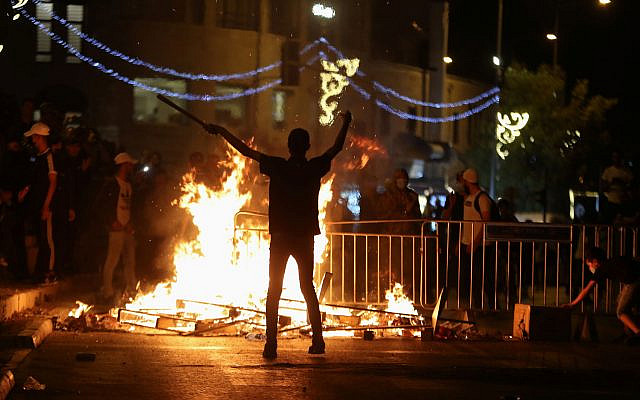 A Palestinian protester during clashes with Israeli police at Damascus Gate on Saturday night (Photo: Reuters/Ronen Zvulun) via Jewish News