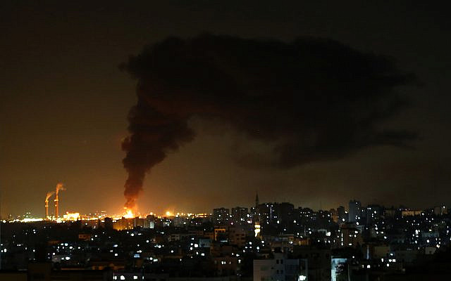 GAZA CITY, GAZA - MAY 12: Fire erupts at Energy facility in Ashkelon city after it was hit by rockets fired from Gaza in response to Israeli airstrikes on the Gaza Strip, on May 12, 2021. (Photo by Ashraf Amra/Anadolu Agency via Getty Images)
