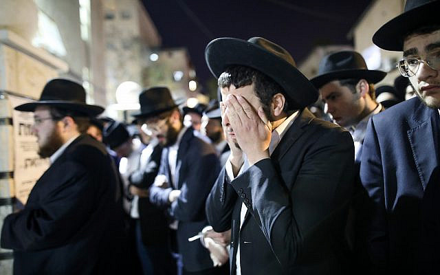 Mourners attend a funeral in Jerusalem for one of the victims of the Mount Meron tragedy, May 2, 2021. (Noam Revkin Fenton/Flash90)