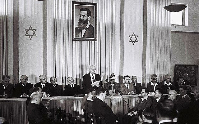 TEL AVIV, ISRAEL - MAY 14:  In this handout from the GPO, David Ben Gurion, who was to become Israel's first Prime Minister, reads the Declaration of Independence May 14, 1948 at the museum in Tel Aviv, during the ceremony founding the State of Israel. (Photo by Zoltan Kluger/GPO via Getty Images) *** Local Caption *** David Ben Gurion