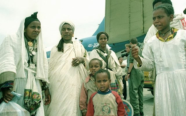 In one of the most well orgnized and coordinated operation ever mounted from Israel, 14,400 Ethiopian Jews were airlifted to Israel from Adis Ababa in just one 30-hour period. The transport divisionof the Israel Air Force, together with planes from El-Al, made 40 round trips to the Ethipian capital to bring out almost all the remaining Jews In Ethiopia. One El-Al cargo Jumbo entered an aviation record as it lifted off from Addis airport with 1080 passengers. Most of the aircraft had all their seats removedand the floor of the cabinwas spead with mattresses covered with nylon so that the maximum number of passenger could be accomodared.. Photo shows: families shortly after leaving the plane on their arrival at Eilat airport.  25/05/91  Copyright © IPPA  20699-005-05                 Photo Gadi Cavallo
