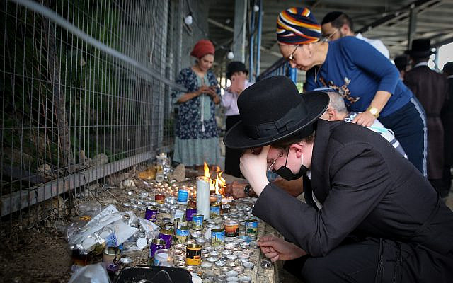 Orthodox Jewish visit the site where a few days ago 45 Israelis were killed in a stampede, at a mass event during a Lag b'Omer event, in Meron, Northern Israel, on May 3, 2021. Photo by David Cohen/Flash90