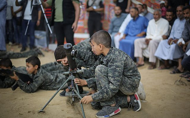 One of the many things that must change for peace between Israelis and Palestinians: Children affiliated with the Hamas terror group display a representation of breaking through the border with Israel and taking over an IDF military post, in Gaza City, on September 1, 2019. (Hassan Jedi/Flash90)
