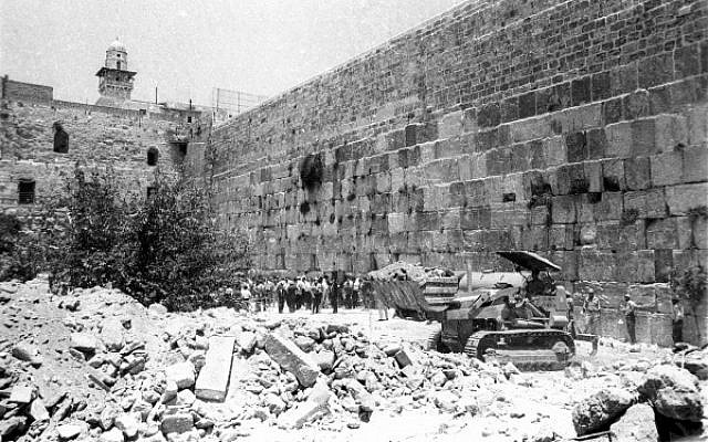 Bulldozers clear the rubble of houses nearest to the Western Wall, June 11, 1967. (From the collection of Dan Hadani, National Library of Israel/Times of Israel).