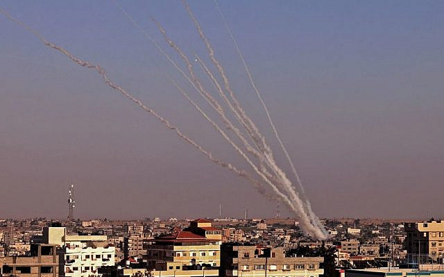 Rockets are launched towards Israel from Rafah, in the southern the Gaza Strip, controlled by the Palestinian Hamas movement, on May 12, 2021. - Heavy exchanges of rocket fire and air strikes, and rioting in mixed Jewish-Arab towns, fuelled fears today that deadly violence between Israel and Palestinians could spiral into 'full-scale war.' (SAID KHATIB / AFP) (Photo by SAID KHATIB/ AFP via Getty Images)