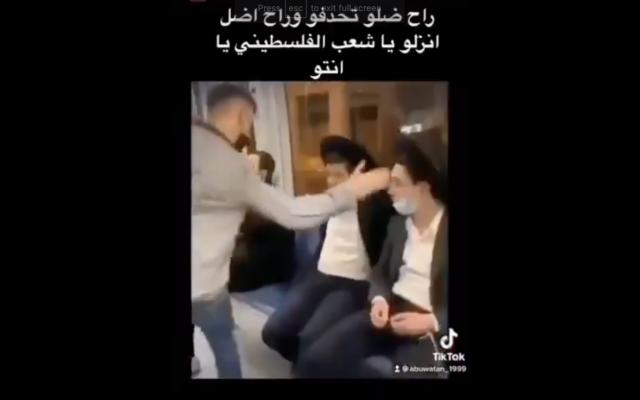Screen capture from a TikTok a video of a Palestinian teen slapping Jewish passengers on the Jerusalem light rail train, April 15, 2021