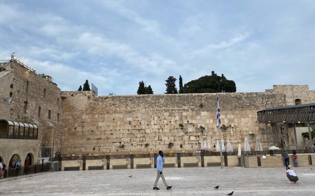A man walking across the Western Wall, a holy site for Jews in Jerusalem. Taken by me.