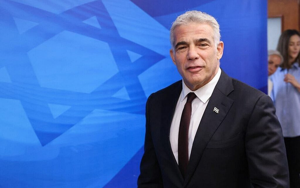 Foreign Minister Yair Lapid arrives for the weekly cabinet meeting at the Prime Minister's Office in Jerusalem, on June 20, 2021. (Emmanuel Dunand/Pool/AFP)