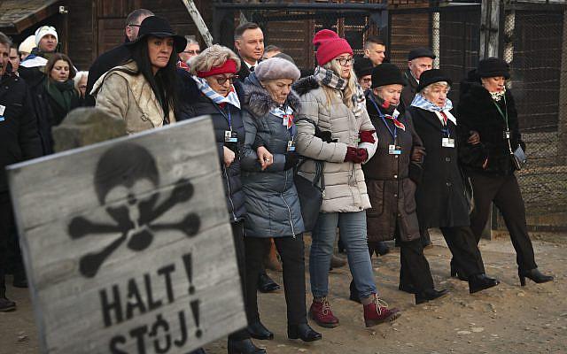 Poland's President Andrzej Duda walks along with survivors through the gates of the Auschwitz Nazi concentration camp in Oswiecim, Poland,  .(AP Photo/Czarek Sokolowski) Via Jewish News