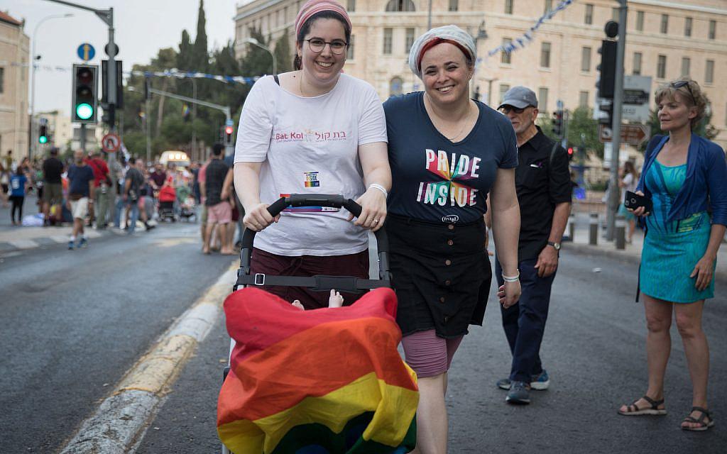 People take part in the annual Gay Pride Parade in Jerusalem, on June 6, 2019. (Noam Revkin Fenton/Flash90)