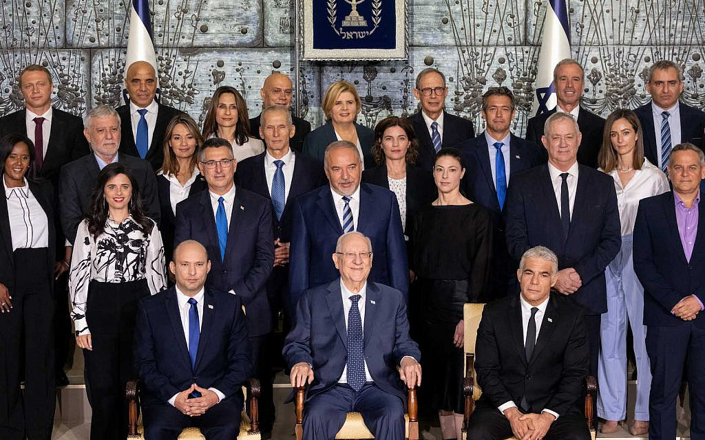 The newly sworn in Israeli government pose for a group photo at the president's residence in Jerusalem on June 14, 2021.(Yonatan Sindel/Flash90)