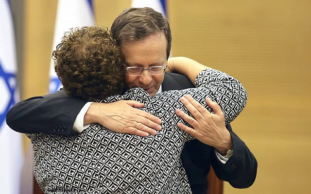 Candidate for President Miriam Peretz hugs elected President Isaac Herzog after knowing the results at the Knesset. Photo:© Ariel Jerozolimski