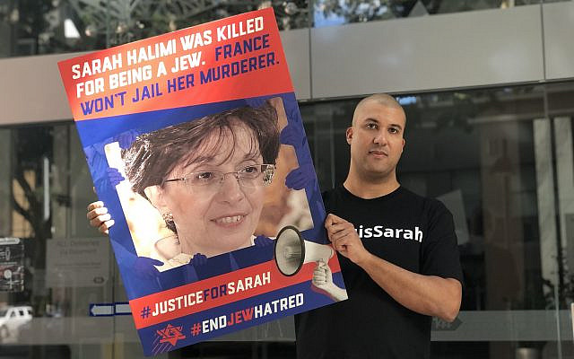 Tunde Reid-Kapo petitioning President Emmanuel Macron and the French Government to reverse the ruling in the case of Dr. Sarah Halimi which freed her murderer, outside the French embassy in Brisbane Australia on May 22, 2021.