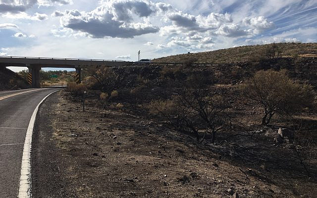 A burned-out portion of desert along I-17 near Sunset Point, on August 26, 2019 in Mayer, Arizona Around the Southwest, people are longing for seasonal rainstorms. The weather pattern characterized by a shift in wind patterns and moisture being pulled in from the tropical coast of Mexico arrives like clockwork each year. But this summer is different. The Southwest is parched. (AP Photo/Paul Davenport)