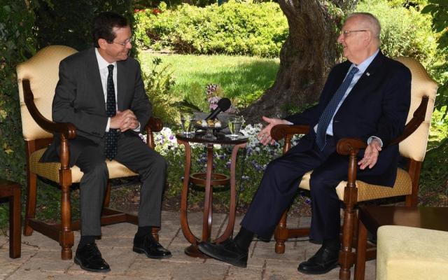 President Reuven Rivlin (R) hosts President-elect Isaac Herzog at the President's Residence in Jerusalem on June 7, 2021. (Mark Neyman/GPO)