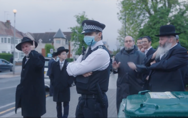 Met officers look on as an elderly Jewish man confronts the two Youtubers (Jewish News)